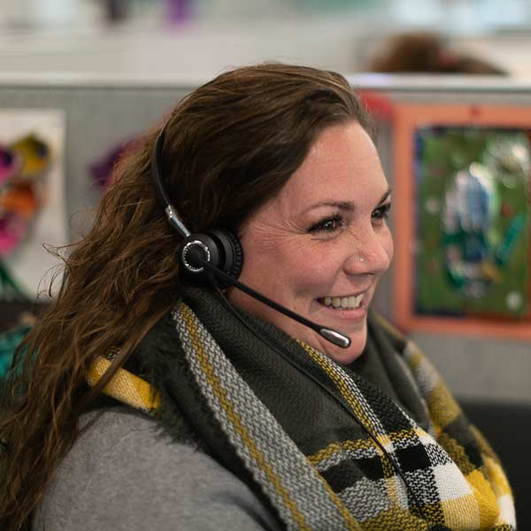 A LimoLink employee with headset