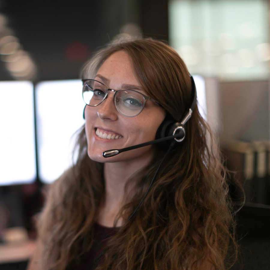 A LimoLink employee smiles while wearing a headset